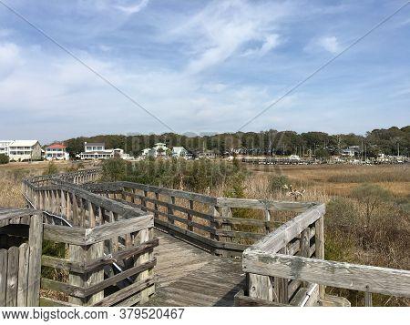 Wooden Walkway Over A Marsh Near The Ocean