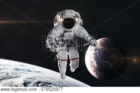 Astronaut In Outer Space. Planets In Deep Space. Science Fiction. Elements Of This Image Furnished B
