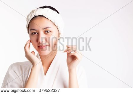 Pretty Woman Cleaning Beautiful Face By Wiping, Using Cotton Pads, Cleansing Lotion, Facial Toner. A