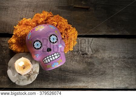 Composition With Typical Mexican Skull And Cempazuchitl Flowers On Rustic Wooden Table.