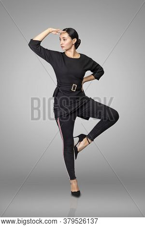 Beautiful Young Brunette Model Posing In Studio Wearing Black Clothes.