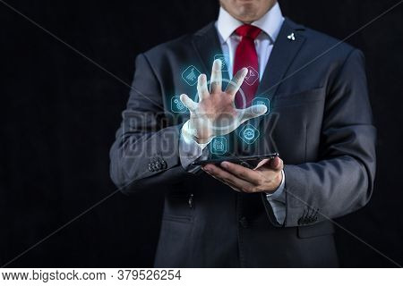 Elegant Businessman And Technology With Virtual Portfolio Of Clients And Contacts On Dark Background