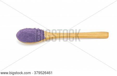 Wooden Spoon With Shadow Makeup Puprle Powder On White Background.