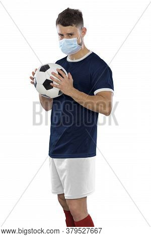 Young Soccer Player With Blue Shirt And Mask In Face On White Background