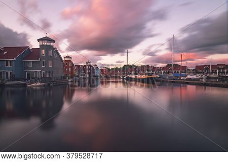 Panorama Of Groningen Harbor In Holland At Sunrise. In The Harbor There Are Boats And In The Blue Sk