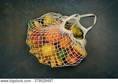 Close Up Assorted Fresh Fruits In Reusable String Mesh Shopping Bag On The Floor Or Table, Elevated