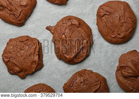 Close Up Several Freshly Baked Round Brownie Chocolate Cookies On Baking Paper, Elevated Top View, D
