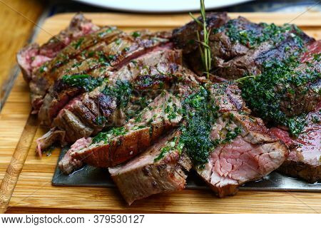 Close Up Big Portion Of Sliced Grill Roasted Beef Chateaubriand Tenderloin Meat With Thyme And Herbs