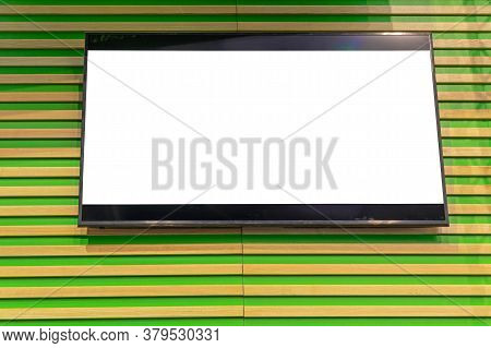 Lcd Tv Screen At Wooden Cabin Wall