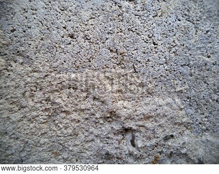 Background Of Stone Chips. Pattern Of Light Gray Stone. The Texture Of The Stone.