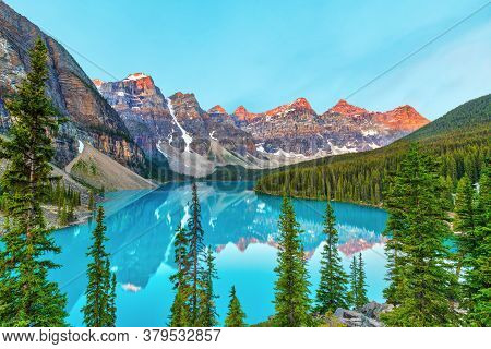 Summer Sunrise Lighting Up The Valley Of The Ten Peaks At Moraine Lake Near Lake Louise In The Canad