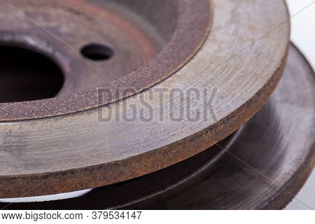 Close-up Of Element Of Old Brake Discs Covered With Rust On White Background In Photography Studio.