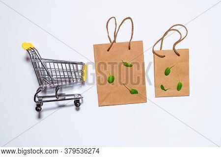 Brown Empty Kraft Paper Bags On White Background. Packaging Template Mockup. Top View Package