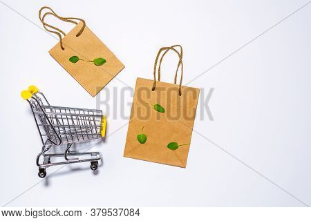 Mini Shopping Cart, Eco-friendly Paper Bag For Shopping In Hypermarkets On White. Top View