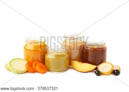 Glass Jars With Nutrient Baby Food Isolated On White Background. Vegetable And Fruit Puree