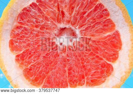 Red Citrus- Fruit Slices Of Grapefruit. To Close. Ripe Juicy Fruit In Water, Under Water, For Juice