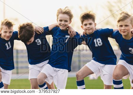 Kids Soccer Players Celebrate A Winning In School Sports Tournament. Happy Boys In A Football Team