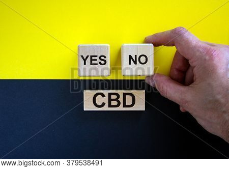Man Holds A Cubes With Word 'no'. Wooden Cubes With Word 'yes' And Word 'plan'. Beautiful Yellow And