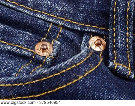 India, New Delhi - May 1, 2019:close Up Of The Levi's Buttons On Old Blue Jeans.