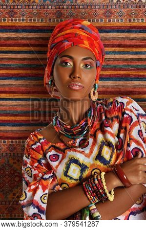 Portrait Of A Young Pretty African American Black Woman In The National African Clothes Against The