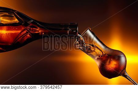 Pouring Alcoholic Drink In Glass With Natural Ice. Steamed Glass With Strong Alcoholic Drink. Copy S