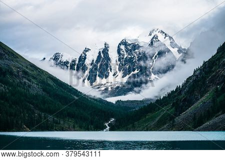 Beautiful Big Glacier, Rocky Snowy Mountains, Coniferous Forest On Hills, Mountain Lake And Highland
