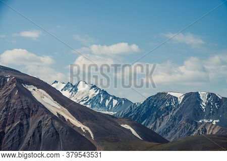 Atmospheric Alpine View To Big Mountain With Snowy High Sharp Tops. Scenic Highland Landscape With G