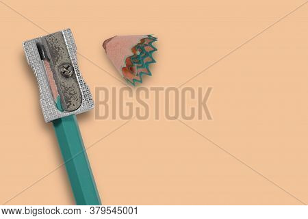 Sharpened Pencil Sharpener When Used On White Background. Concept Preparing To Go Back School