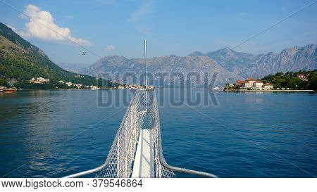 Front View Of Sea And Mountains In Front Of The Bow Of A Cruise Ship. A View From The Deck To The Bo