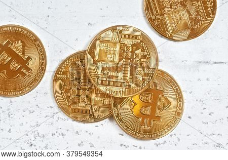 Overhead Shot, Golden Commemorative Btc - Bitcoin Cryptocurrency - Coins Scattered On White Stone Bo