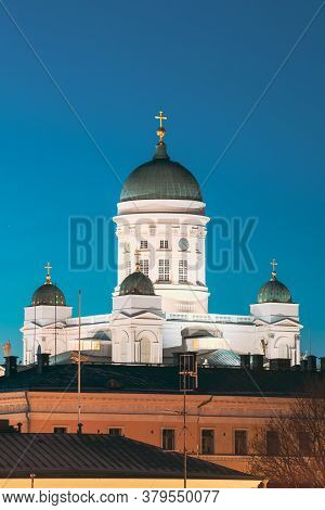 Helsinki, Finland. Famous Landmark Is Lutheran Cathedral In Night Evening Lighting.