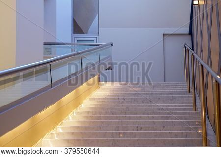 Wide Staircase To The Hotel Lobby. Stairway In Office Building. Closeup And Details Of Railing And S