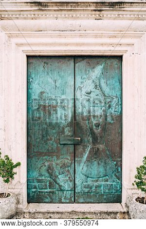 Close-up Of Green Painted Doors To The Church Of Our Lady.