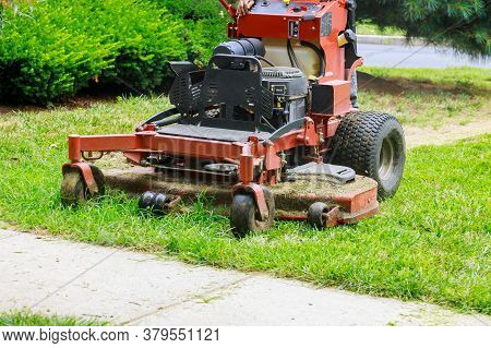 Home Garden Grass Gardener Cutting Lawn Grass With Lawn Mower Man Using A Lawn Mower A Gardener Cutt