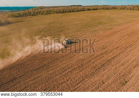 Ukrainian Fields Are Cultivated By A Tractor, The Field Is Cultivated Before Sowing Grain, Top View,
