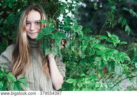 Teen girl in the forest or Park. With space for your text.