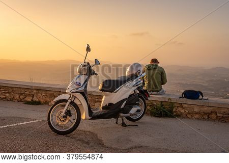 Es Mercadal, Menorca - October 13, 2019: A Man With Scooter On The Top Of El Toro Mountain On Menorc