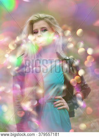 Stylish Blonde Girl In A Shining Bokeh Light. Beauty Fashion Model And Bokeh.