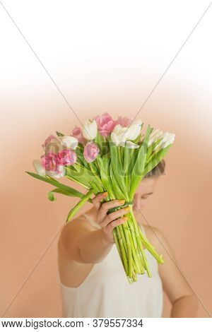 Young Lovely Girl Holding Pink Tulips Bouquet At Springtime