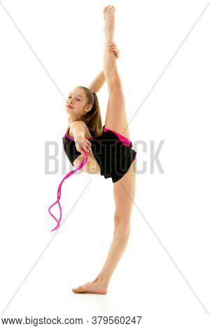 Girl Gymnast Performs Exercises With A Skipping Rope. The Concept Of A Healthy Lifestyle, Sport. Iso