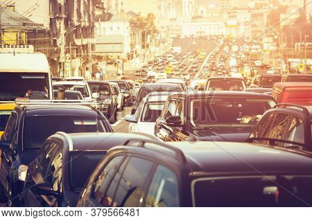 A Lot Of Cars Standing In A Traffic Jam At Sunset
