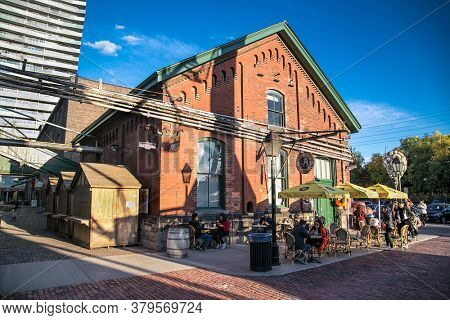 Toronto, Canada-Oct 24, 2019: Distillery District (former Gooderham & Worts Distillery) - historic and entertainment precinct. It contains numerous cafes, restaurants, shops . Toronto. Canada.