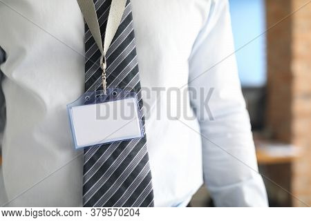Close-up Of Executive Manager Posing In Costume And Wearing Empty Paper Name Tag. Businessman In Cab