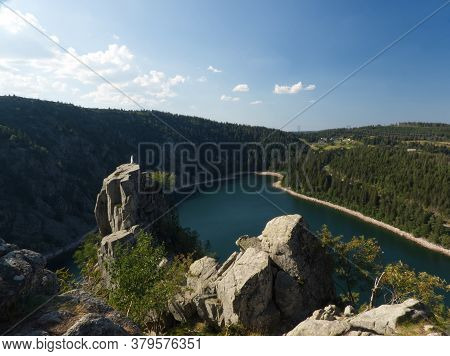 Wonderful View On The White Lake In The Vosges With Shadow Effects And Impressive Cliffs