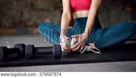 Girl Stretching Or Yoga In Gym.young Woman Work Outing Or Pilates. Regular Sports Boosts Immune Syst