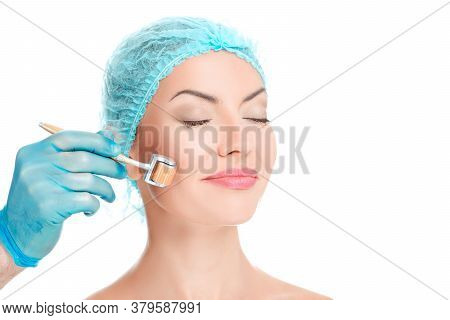 Medical Cosmetic Procedure. Micro-needling Therapy. Beautician Performs Dermaroller Procedure, Young