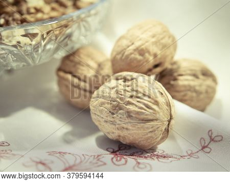 Whole Walnuts And Kernels On White Scarf