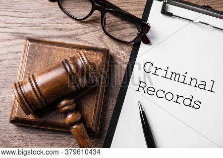 Clipboard With Words Criminal Record And Gavel On Wooden Table, Flat Lay