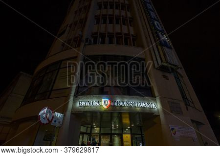 Brasov, Romania - February 14, 2020: Logo Of Banca Transilvania (bank Of Transylvania) At Night On A