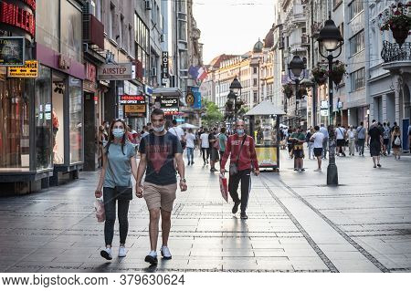 Belgrade, Serbia - July 21, 2020: Young People, A Couple, Walking And Holding Hands In A Belgrade St